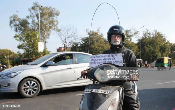 Two wheeler rider with a makeshift innovation and an awareness message against the use of glass coated manjha thread used to fly kites, on the eve of...