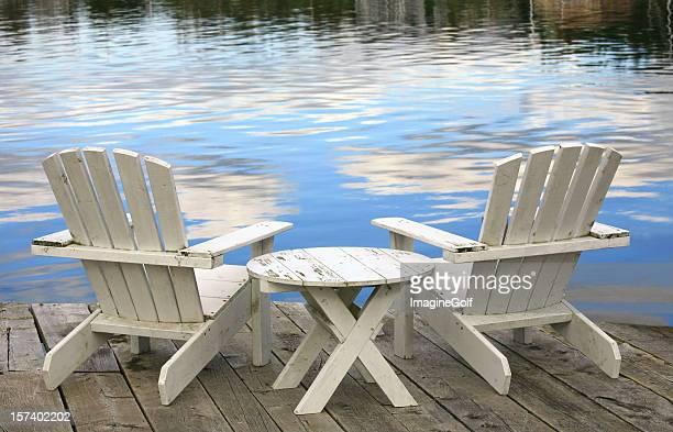 Two White Adirondack Chairs
