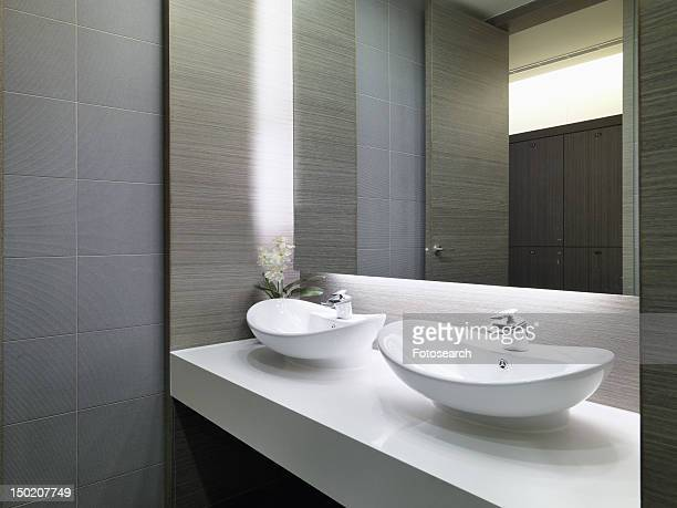 Two white bowl sinks on countertop