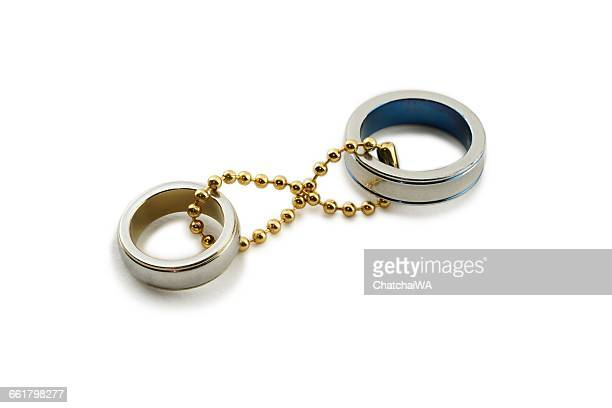 Two white gold wedding rings chained together