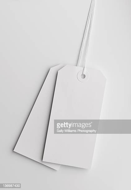 Two white luggage tags