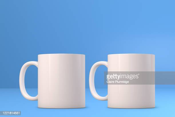 two white mugs mockup on a blue background. perfect for businesses selling mugs, just overlay your quote or design on to the image. - ウェスト・バークシャー ストックフォトと画像