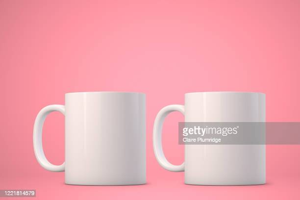 two white mugs mockup on a cyan background. perfect for businesses selling mugs, just overlay your quote or design on to the image. - ウェスト・バークシャー ストックフォトと画像