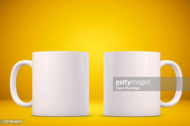 two white mugs mockup on a yellow background. perfect for businesses selling mugs, just overlay your quote or design on to the image. - ウェスト・バークシャー ストックフォトと画像