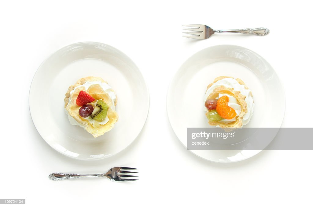 Two White Plates with Cream Puffs Eclairs : Stock Photo