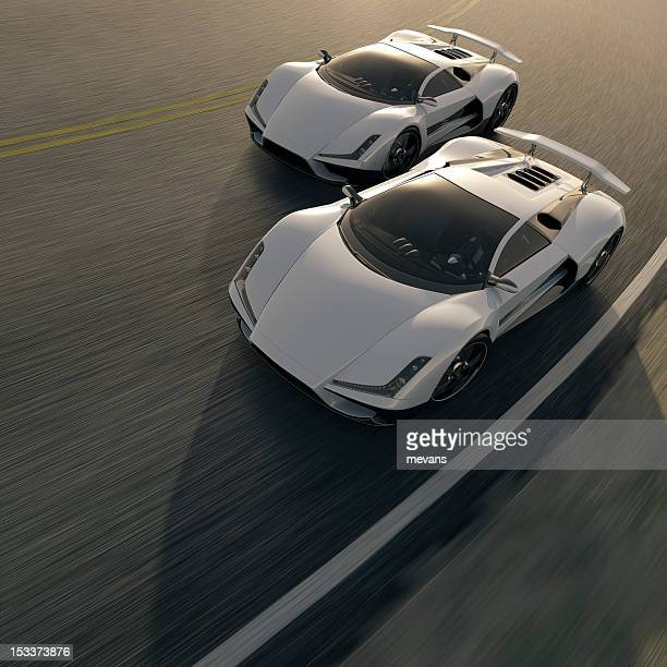 Two white street cars having a competition on the road