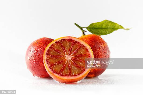Two whole and one half blood orange