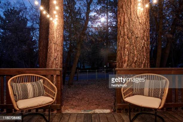 two wicker chairs on verandah of house - heshphoto stock pictures, royalty-free photos & images