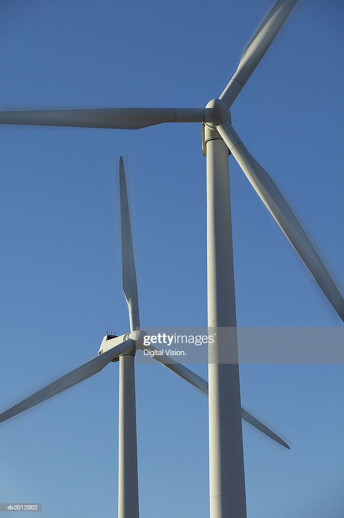Two Wind Turbines Against a Blue Sky : Stock Photo