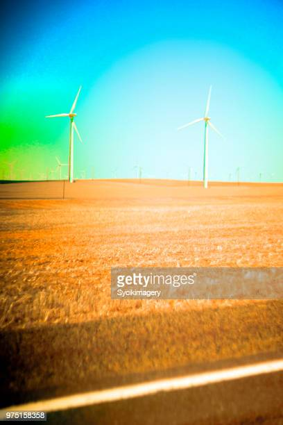 Two wind turbines along highway