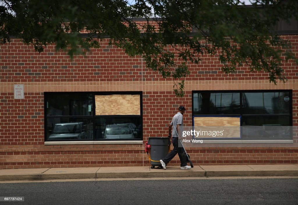 Two windows at the YMCA building broken by bullets are shown boarded up near the Eugene Simpson Stadium Park, the site where House Majority Whip Rep. Steve Scalise was shot by gunman James Hodgkinson, June 19, 2017 in Alexandria, Virginia. Investigators have concluded their investigation at the shooting scene and the area has been reopened to the public.