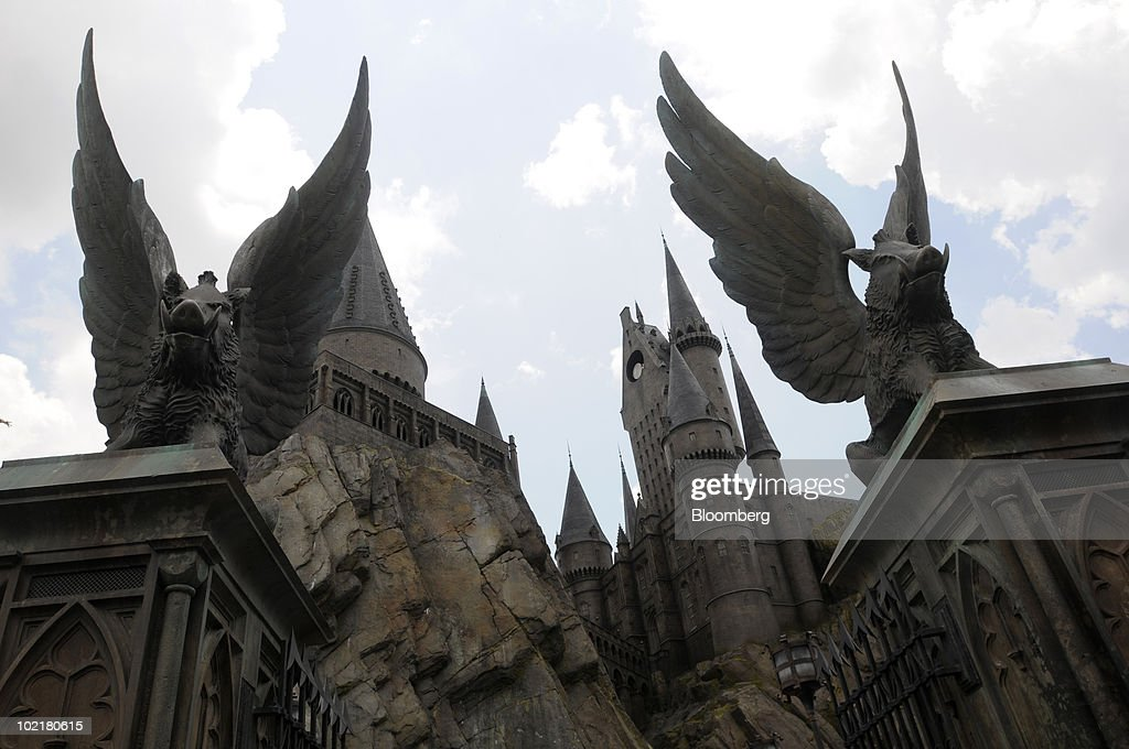 Two winged boars sit atop the entrance gates to Hogwarts castle at the Universal Studios Wizarding World of Harry Potter theme park in Orlando, Florida, U.S., on Thursday, June 17, 2010. Universal reportedly spent $265 million building the theme park, based on a Securities & Exchange Commission filing. Photographer: Phelan M. Ebenhack/Bloomberg via Getty Images