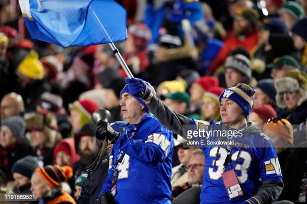 Two Winnipeg Blue Bombers fans during the Grey Cup against the Hamilton Tiger-Cats at McMahon Stadium on November 24, 2019 in Calgary, Canada....