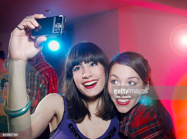 two woman at part doing self portrait with camera - only young women stock pictures, royalty-free photos & images