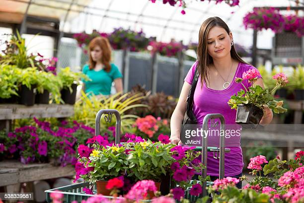 Two Woman Customers Shopping for Plants at Garden Center.