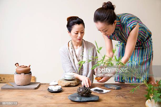 Two Woman Discussing Tea Ceremony