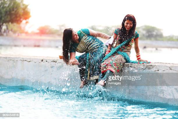Two woman doing fun in lake water