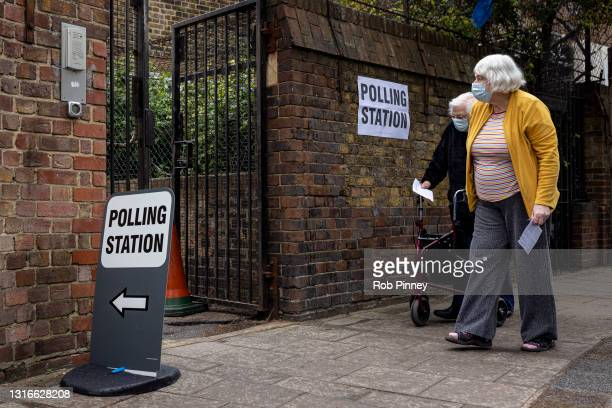 Two woman going to vote at a polling station on May 06, 2021 in London, England. The London mayoral election takes place today a year after the...
