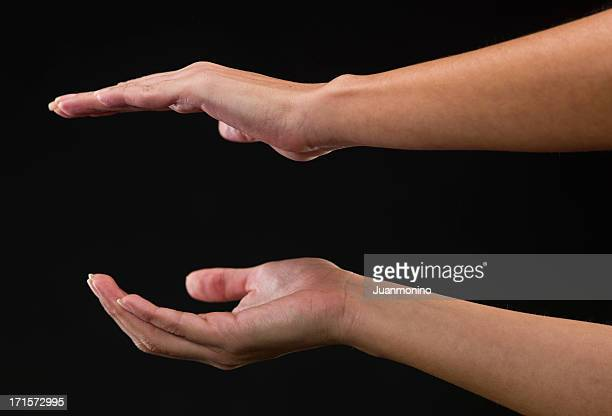 two woman hands holding an object - positioning stock pictures, royalty-free photos & images