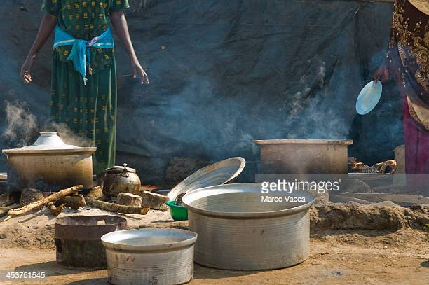 Two woman in an open air kitchen