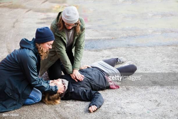 two woman performing reanimation - heart attack stock photos and pictures