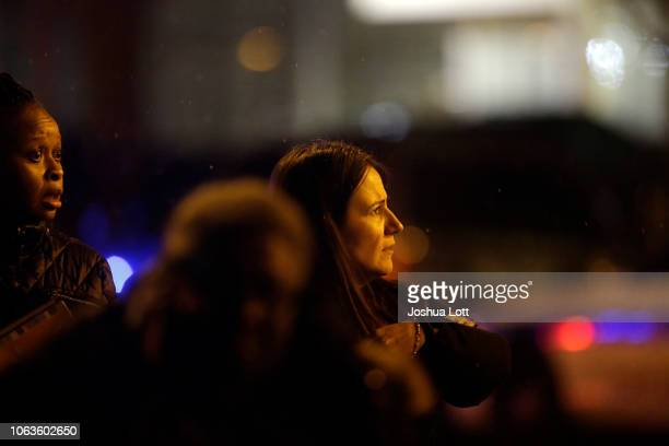Two woman react as they speak to a police officers outside Mercy Hospital after a gunman shot multiple people on November 19 2018 in Chicago Illinois...
