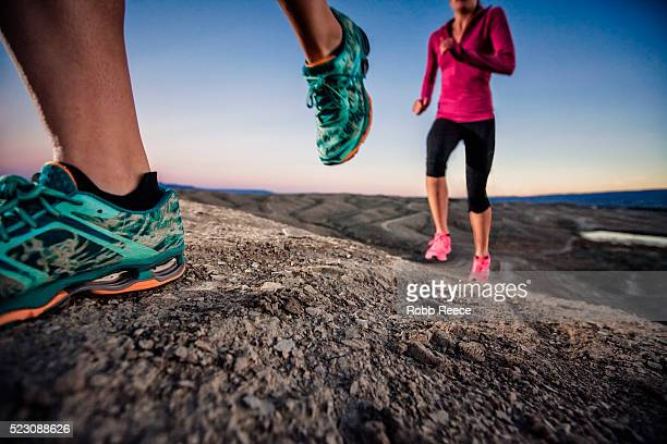 two woman trail runners on desert trail, grand junction, colorado, usa - robb reece stock pictures, royalty-free photos & images