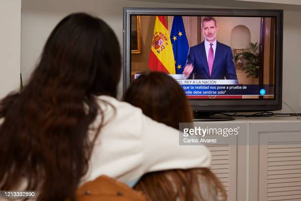 Two woman watching the King Felipe VI of Spain speech at home on March 18, 2020 in Madrid, Spain. King Felipe VI of Spain speaks to the Nation due to...