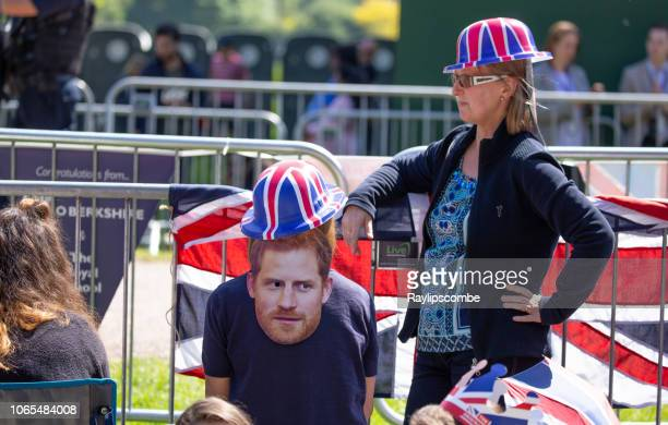 two woman wearing union jack bowler hats  celebrating the marriage of meghan markle and prince harry at st george's chapel at windsor castle - meghan stock photos and pictures