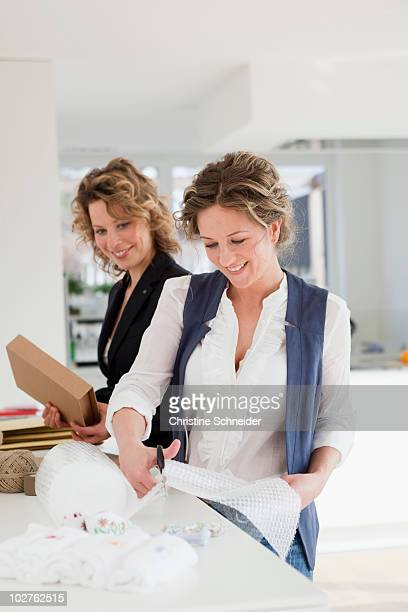 Two woman working together