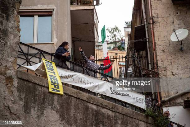 Two womans during the 6pm flashmob on March 13, 2020 in Naples, Italy. The Italians met on the balconies of their homes in a sound flashmob that...