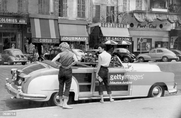 Two women admire a 1947 Chrysler Town Country convertible car in Marseille Original Publication Picture Post 7226 We Hitch Hiked To The Sun On 5 pub...