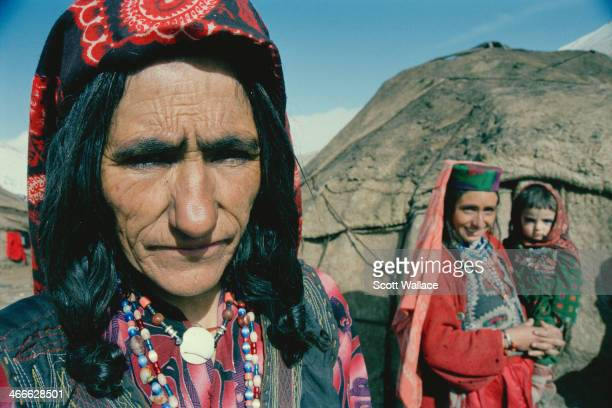 Two women and a child of a nomadic people at a yurt encampment in the Wakhan Corridor of northeastern Afghanistan 2004