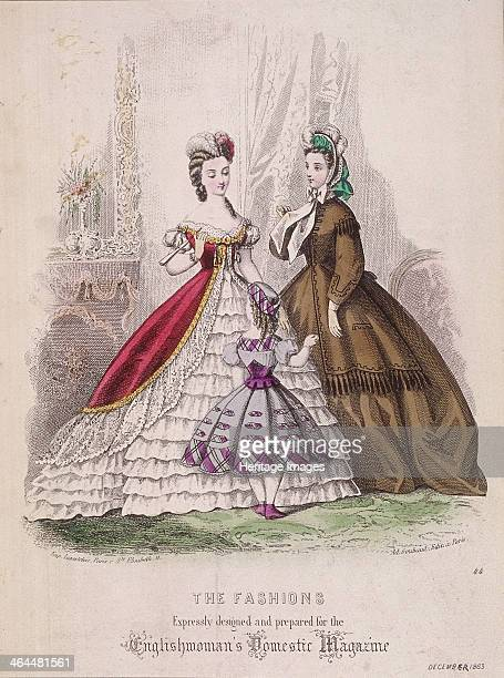 Two women and a little girl model the latest fashions 1863 The woman on the left is dressed in an off the shoulder evening dress with a full...