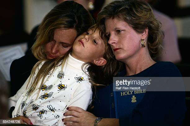 Two women and a little girl pray during a memorial service at Westminster Presbyterian Church for the victims of the Oklahoma City Bombing On April...