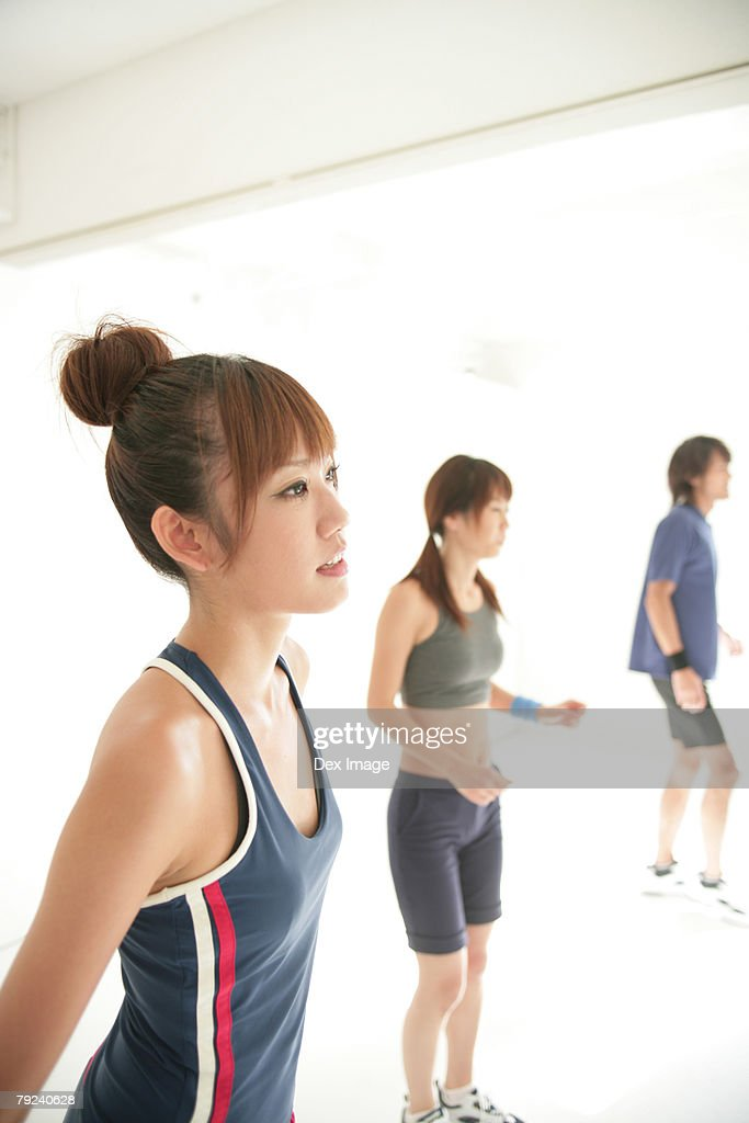 Two women and a man doing aerobics, close-up : Stock Photo