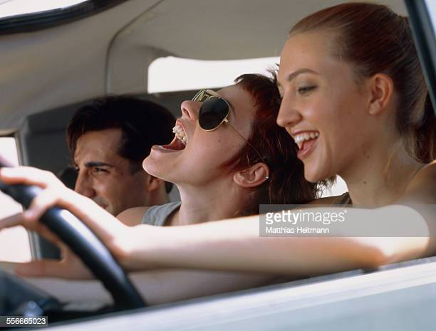 Two women and a man in a car