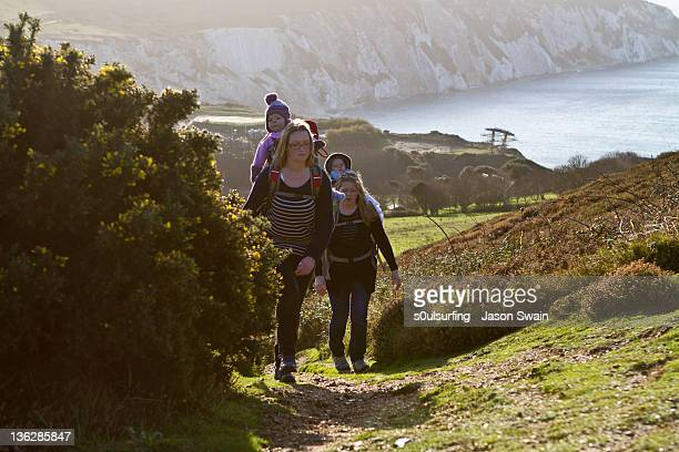 two women and babies walking on coastal - s0ulsurfing stock pictures, royalty-free photos & images
