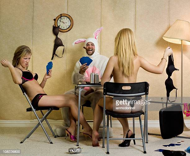 Two Women and Man Playing Strip Poker