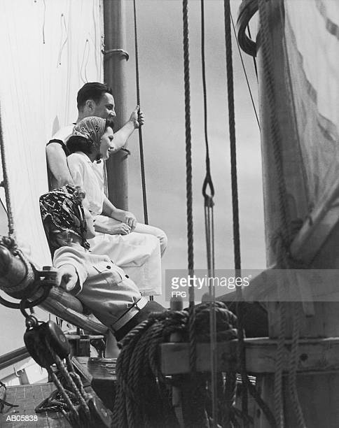 two women and man relaxing on sailboat (b&w) - voilier noir et blanc photos et images de collection