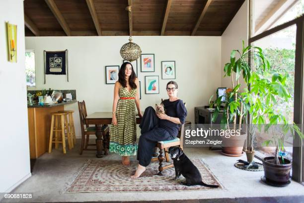 Two women and two dogs in their home