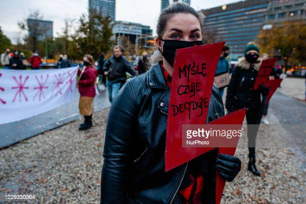 Two women are holding placards with the red symbol against the abortion ban, during the protest against the abortion ban In Poland, that took place...