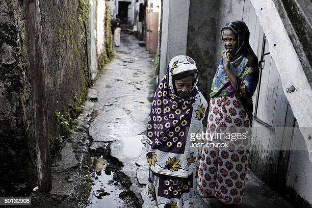 Two women are pictured in the old city of Moroni the capital of the Union of Comoros on March 5 2008 The renegade Comoros island of Anjouan is...