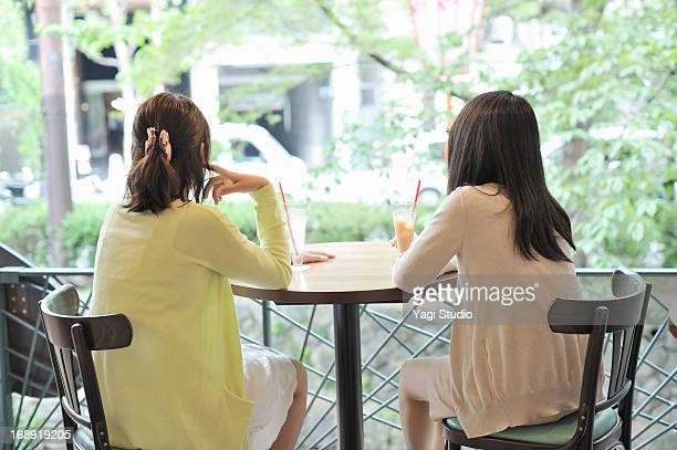 Two women are relaxing in a cafe
