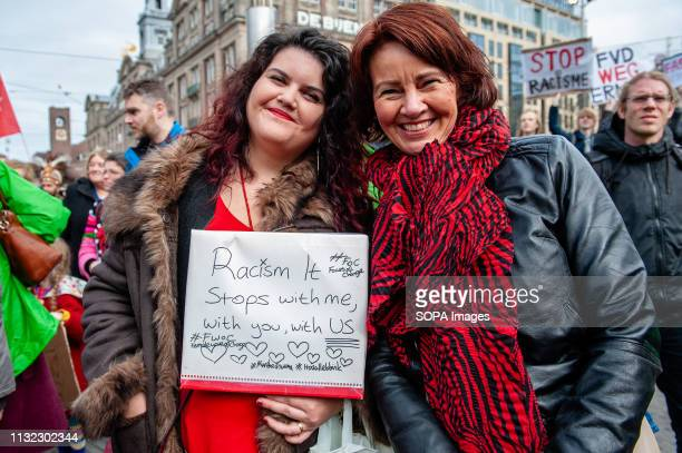 Two women are seen holding a placard during the demonstration Thousands of people gathered at the Dam square in the center of Amsterdam to...