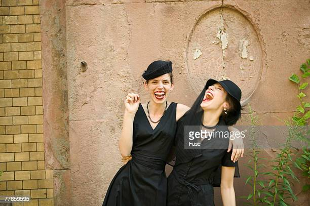 Two Women at a Funeral Laughing