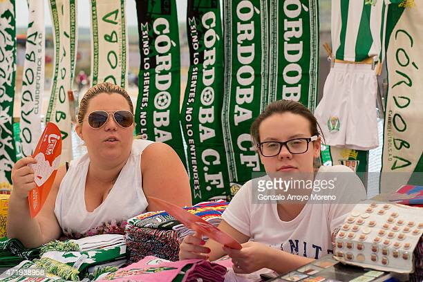 Two women at a merchandaising stall fan themselves before the La Liga match between Cordoba CF and Barcelona FC at El Arcangel stadium on May 2 2015...