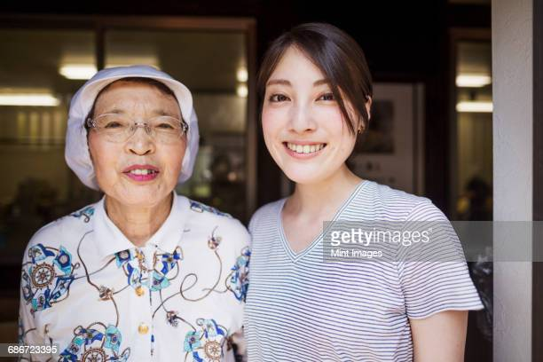 Two women at a noodle shop, a small unit with a fast food kitchen and unit producing Soba noodles