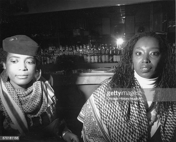 Two women at the Black is Back benefit for the Center for Inner City Studies at Northeastern Illinois University held at the Chicrick House at 2512...