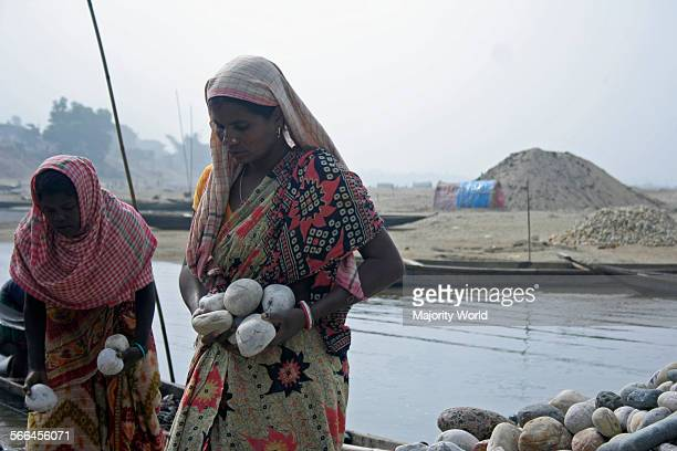 Two women at work on a bank of the Dauki river The river in its downward journey from the Himalayas carries an abundance of rocks and boulders and...